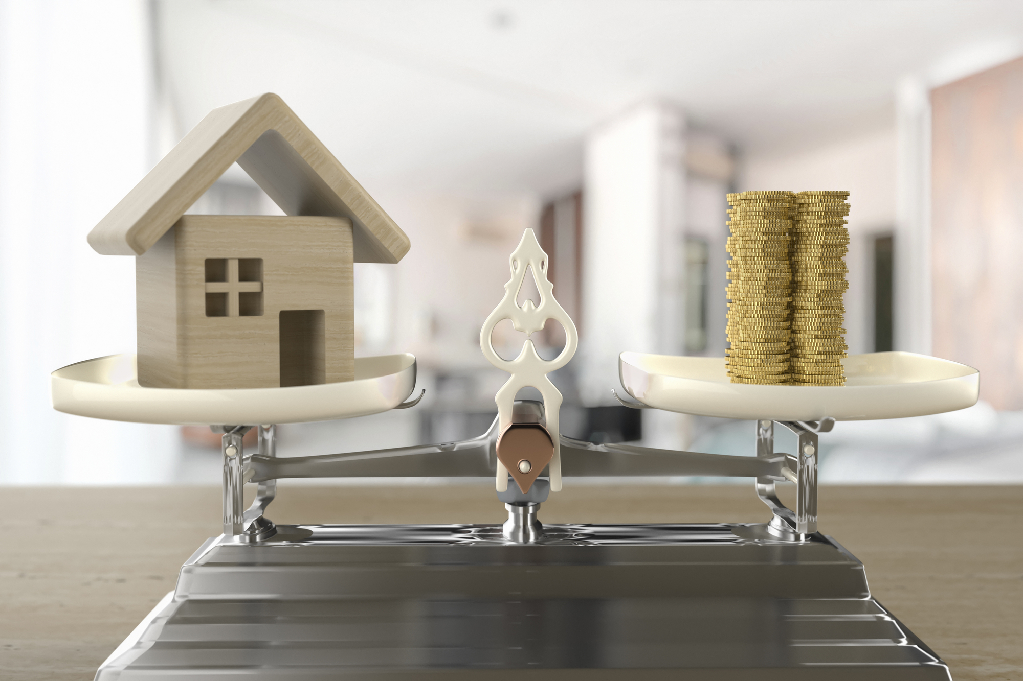 House and coins on the scale as an illustration of a home loan and other real estate expenses